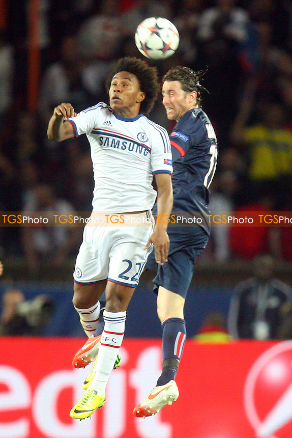 Willian  of Chelsea and Maxwell of Paris St-Germain - Paris St Germain vs Chelsea, Champions League Quarter Final Football at the Parc Des Princes Stadium - 02/04/14 - MANDATORY CREDIT: Dave Simpson/TGSPHOTO - Self billing applies where appropriate - 0845 094 6026 - contact@tgsphoto.co.uk - NO UNPAID USE