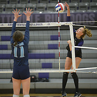 NWA Democrat-Gazette/ANDY SHUPE<br /> Fayetteville's Ella May Powell (right) sends the ball over the net as Har-Ber's Mackenzie White defends Wednesday, Sept. 13, 2017, during play in Bulldog Arena. Visit nwadg.com/photos to see more photographs from the match.