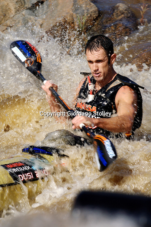 DUSI RIVER - 18 January 2006 - Jason Graham on Day 1 of the 57th edition of the annual Dusi Canoe Marathon between Pietermaritzburg and Durban. He finished 6th on Day one, but by the end of the race fell out of the top 10..Picture: Giordano Stolley / Allied Picture Press