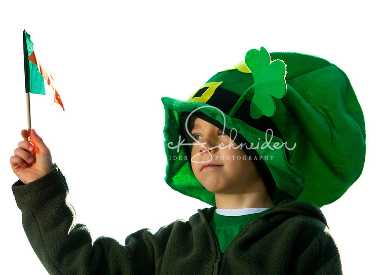 A youngster wearing a large green hat waves his flag during the St. Patrick's Day Parade. Thousands of people turned out to watch the annual St. Patrick's Day Parade in Uptown/Downtown Charlotte, North Carolina. (model released)