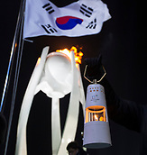 9th February 2018, Pyeongchang, South Korea; 2018 Winter Olympic Games; PyeongChang Olympic Stadium; The Olympic Flame held in front of the South Korean flag and lit cauldron