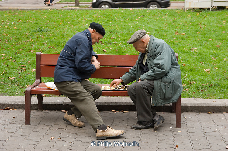 Elderly men play chequers in Prospekt Svobody in the centre of Lviv.
