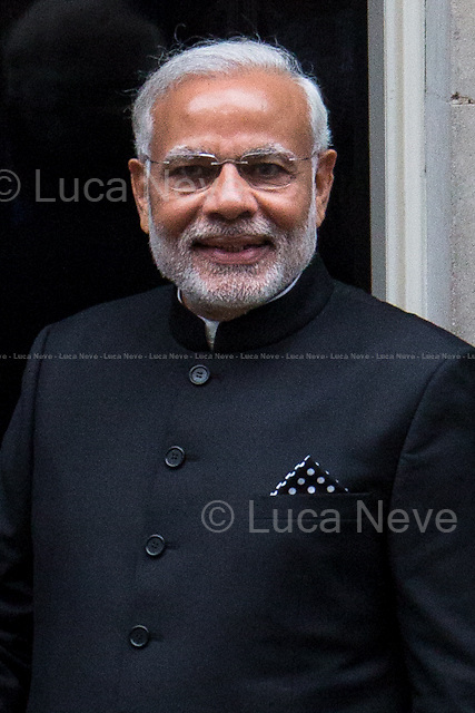 Narendra Modi (Indian Prime Minister).<br /> <br /> London, 12/11/2015. Today, the Prime Minister of India Narendra Modi (Leader of the Bharatiya Janata Party, BJP; former Chief Minister of Gujarat from 2001 to 2014; actual Member of Parliament from Varanasi) met the British Prime Minister David Cameron at 10 Downing Street during his visit to the UK. After the meeting, the two Prime Ministers went to Parliament Square (cleared from traffic and members of the public) to pay tribute to the Mahatma Gandhi statue and to see the Red Arrows performing a flypast over Westminster. In the meantime, Sikh and Kashmir people protested patrolled by heavy police presence.