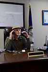 Lonnie Hendrix talks on the phone and smokes his electronic cigarette in his office on Wednesday, October 9, 2013. Hendrix had been smoking up to three packs a day and recently decided to break the habit to better his health for himself and his town. Photo by Leah Klafczynski