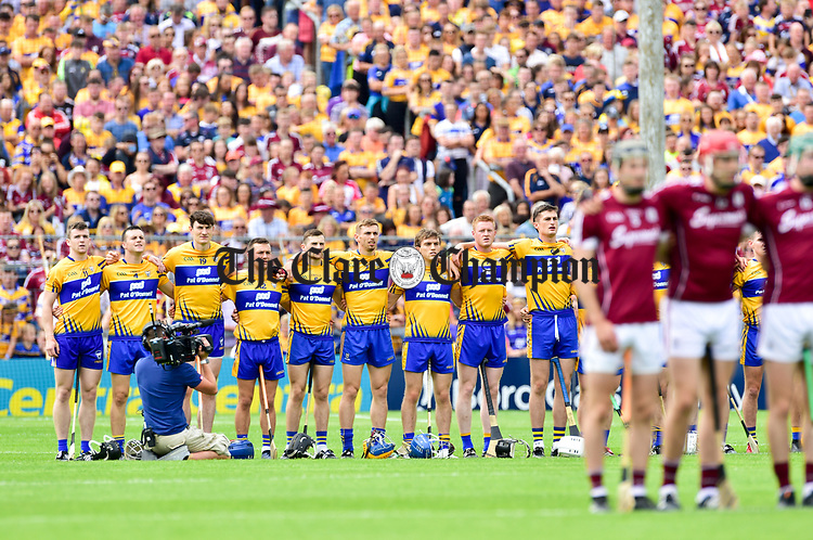 The Clare team marches stand for the anthem before the All-Ireland semi-final replay against Galway at Semple Stadium,Thurles. Photograph by John Kelly.
