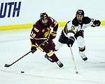 SIOUX FALLS, SD - MARCH 23: Parker Mackay #39 from Minnesota Duluth controls the puck past Riese Zmolek #25 from Mankato during their game at the 2018 West Region Men's NCAA DI Hockey Tournament at the Denny Sanford Premier Center in Sioux Falls, SD. (Photo by Dave Eggen/Inertia)