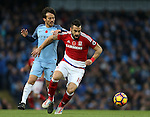 David Silva of Manchester City tussles with Alvaro Negredo of Middlesbrough during the Premier League match at the Etihad Stadium, Manchester. Picture date: November 5th, 2016. Pic Simon Bellis/Sportimage