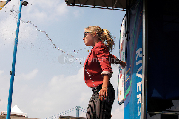 Emily Osment performing at Fam Jams at Penns Landing in Philadelphia, Pa on July 3, 2011  © Star Shooter / MediaPunchInc 2011