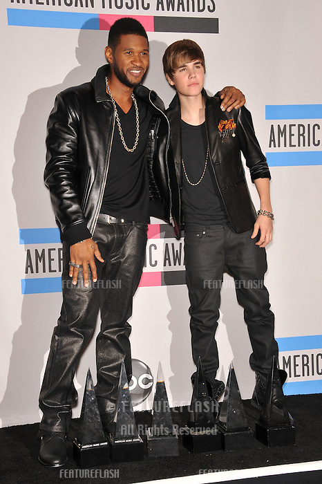 Usher & Justin Bieber (right) at the 2010 American Music Awards at the Nokia Theatre L.A. Live in downtown Los Angeles..November 21, 2010  Los Angeles, CA.Picture: Paul Smith / Featureflash