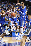 Guard Tyler Ulis leaps to pass during the first half of the Blue-White Scrimmage at Rupp Arena on Monday, October 27, 2014 in Lexington, Ky. Photo by Adam Pennavaria | Staff