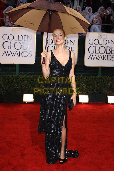 HEATHER GRAHAM.67th Golden Globe Awards held Beverly Hilton, Beverly Hills, California, USA..January 17th, 2010.globes full length black dress umbrella sparkly  .CAP/ADM/KB.©Kevan Brooks/Admedia/Capital Pictures