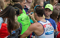 Richard WHITEHEAD of GBR signs items for spectators after his 200m T42 race during the Muller Grand Prix Birmingham Athletics at Alexandra Stadium, Birmingham, England on 20 August 2017. Photo by Andy Rowland.