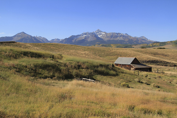 Ranch barn at the base of Sunshine (left) and Wilson Peaks (14,016 ft), San Juan Mountains, Telluride, Colorado, USA.