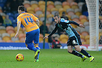 Wycombe Wanderers Michael Harriman keeps a close eye on Mansfield Town's Nathan Thomas during the Sky Bet League 2 match between Mansfield Town and Wycombe Wanderers at the One Call Stadium, Mansfield, England on 31 October 2015. Photo by Garry Griffiths.