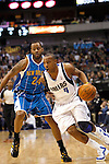 Dallas Maverick's Caron Butler drives against New Orleans Hornets' Morris Peterson during an NBA basketball game at American Airlines Center in Dallas on February 28, 2010.   (Photo by Khampha Bouaphanh)
