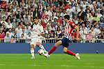 Real Madrid's Marco Asensio and Atletico de Madrid's Rodrigo Hernandez during La Liga match between Real Madrid and Atletico de Madrid at Santiago Bernabeu Stadium in Madrid, Spain. September 29, 2018. (ALTERPHOTOS/A. Perez Meca)