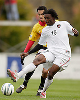 The MetroStars' Fabian Taylor is marked by Orlando Perez of the Fire. The MetroStars defeated the Chicago Fire 2-0 during the inaugural Hall of Fame game on Monday October 11, 2004 at At-A-Glance Field at the National Soccer Hall of Fame and Museum, Oneonta, NY..