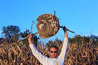 Portrait d'Etienne Roumailhac, 42 years old, hunter of Asian hornets, with an Asian hornets' nest. The nest's size can reach one meter in diameter and the population can exceed 20,000 hornets.///Portrait d'Etienne Roumailhac, 42 ans, chasseur de frelons asiatiques avec un nid de frelon asiatique. La taille des nids peut atteindre un mètres de diamètre et la population plus de 20 000 frelons.
