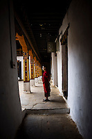 A young Buddhist monk is seen inside the Punakha dzong (fortress) in Punakha, Bhutan.