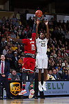 Cornelius Hudson (25) of the Wake Forest Demon Deacons shoots over Mangok Mathiang (12) of the Louisville Cardinals during first half action at the LJVM Coliseum on January 4, 2015 in Winston-Salem, North Carolina.  The Cardinals defeated the Demon Deacons 85-76.  (Brian Westerholt/Sports On Film)