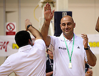 Assistant coach Chris Tupu high-fives head coach Nenad Vucinic during the International basketball match between the NZ Tall Blacks and Australian Boomers at TSB Bank Arena, Wellington, New Zealand on 25 August 2009. Photo: Dave Lintott / lintottphoto.co.nz