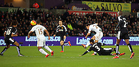 Jack Cork of Swansea takes a shot during the Barclays Premier League match between Swansea City and Watford at the Liberty Stadium, Swansea on January 18 2016