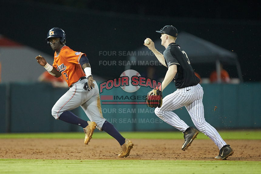 Army Black Knights second baseman Josh White (3) chases Josh Anthony (3) of the Auburn Tigers towards third base at Doak Field at Dail Park on June 2, 2018 in Raleigh, North Carolina. The Tigers defeated the Black Knights 12-1. (Brian Westerholt/Four Seam Images)