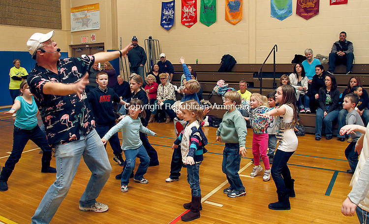 Wolcott, CT-18 FEBRUARY 2012 021812JW06- Former Wolcott teacher T-Bone (Tom Stankus) performs a surfing show with the help of audience members during a fundraiser at Wakelee Elementary School for Wolcott's anti drug group Crossroads Saturday afternoon. .Jonathan Wilcox Republican American..