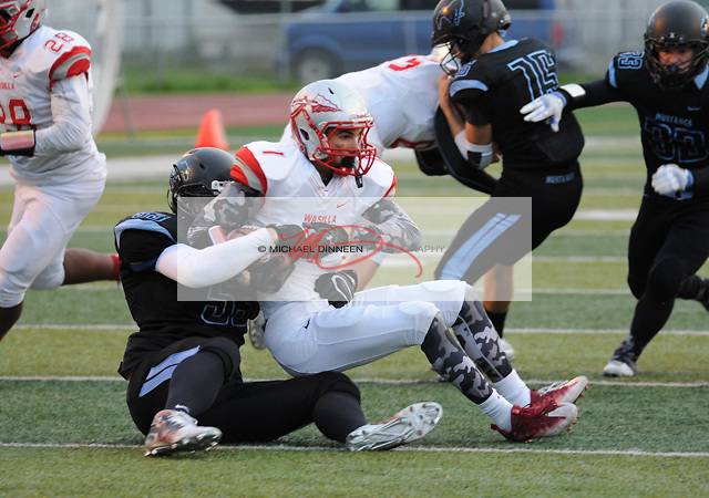 Wasilla quarterback Hunter Honglso is sacked by Mustang linebacker Cody Bailey at Chugiak High School Friday, Sept. 23, 2016.  Photo for the Star by Michael Dinneen