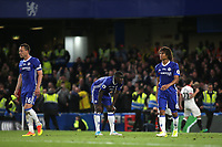 John Terry, Kurt Zouma and Nathan Ake of Chelsea look shellshocked as Watford celebrate scoring their third goal during Chelsea vs Watford, Premier League Football at Stamford Bridge on 15th May 2017