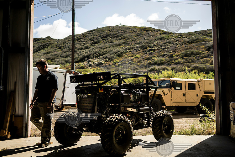 Engineers of the Unmanned Systems Group at Spawar, or Space and Naval Warfare Systems Command, a research and operations arm of the Navy, troubleshoot an autonomous vehicle called RaDer. The group is developing autonomous vehicles for the military, which they think will revolutionise the way the military fights. The challenge is to develop autonomous vehicles sturdy enough to operate in environments where there are no roads.