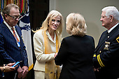Kellyanne Conway, senior advisor to U.S. President Donald Trump, center left, greets Carolyn Welsh, sheriff from Chester County, Pennsylvania, as she arrives to a county sheriff listening session with U.S. President Donald Trump, not pictured, in the Roosevelt Room of the White House in Washington, D.C., U.S., on Tuesday, Feb. 7, 2017. The Trump administration will return to court Tuesday to argue it has broad authority over national security and to demand reinstatement of a travel ban on seven Muslim-majority countries that stranded refugees, triggered protests and handed the young government its first crucial test. <br /> Credit: Andrew Harrer / Pool via CNP