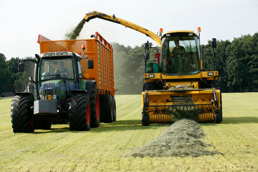 Harvesting grass for animal food during winter, Netherlands.