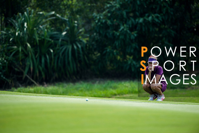 Danielle Montgomery of Great Britain in action during the first day of the World Ladies Championship at the Mission Hills Haikou Sandbelt Trails course on 8 March 2013 in Hainan island, China . Photo by Manuel Queimadelos / The Power of Sport Images