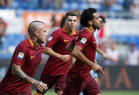 Calcio, Serie A: Roma vs Sampdoria. Roma, stadio Olimpico, 11 settembre 2016.<br /> Roma&rsquo;s Mohamed Salah, right, celebrates with teammates after scoring during the Italian Serie A football match between Roma and Sampdoria at Rome's Olympic stadium, 11 September 2016. Roma won 3-2.<br /> UPDATE IMAGES PRESS/Isabella Bonotto