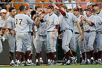 Arizona State Sun Devil bench greets Devan Marrero #17 after he scored against the Texas Longhorns in NCAA Tournament Super Regional baseball on June 10, 2011 at Disch Falk Field in Austin, Texas. (Photo by Andrew Woolley / Four Seam Images)