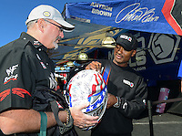 Oct. 26, 2012; Las Vegas, NV, USA: NHRA top fuel dragster driver Antron Brown signs a helmet for a fan during qualifying for the Big O Tires Nationals at The Strip in Las Vegas. Mandatory Credit: Mark J. Rebilas-