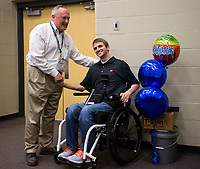 NWA Democrat-Gazette/JASON IVESTER<br /> Tom Woodward, DECA advisor, congratulates Jason Papageorge Friday, April 14, 2017, at a DECA meeting at Rogers High School. Papageorge, a Rogers High alum, was surprised by the club with the announcement of an annual scholarship given by the club in his honor.