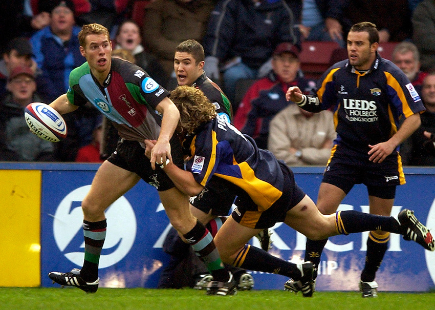 Photo: Richard Lane..NEC Harlequins v Leeds Tykes. Zurich Premiership. 29/11/2003. .Gavin Duffy looks for support in the tackle.