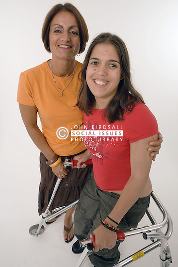 Mother and daughter; with Cerebral palsy; smiling,