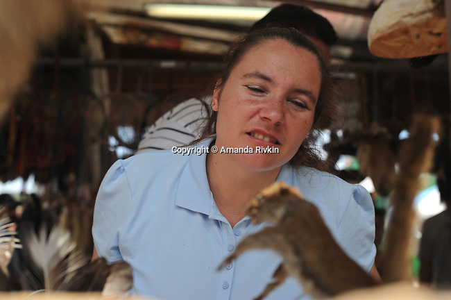 A woman stares at a taxidermy squirrel at a booth at the Wisconsin State Fair in West Allis, Wisconsin on August 3, 2008.
