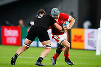 1st November 2019, Tokyo, Japan;  Jonathan Davies (WAL) is tackled by Scott Barrett of New Zealand;  2019 Rugby World Cup 3rd place match between New Zealand 40-17 Wales at Tokyo Stadium in Tokyo, Japan.  - Editorial Use