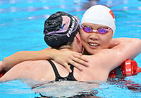 July 30, 2012..Missy Franklin embraces Jing Zhao after winning Women's 100m Backstroke Final at the Aquatics Center on day three of 2012 Olympic Games in London, United Kingdom.