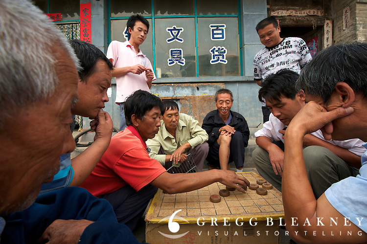 Men play Chinese chess in old town -- stage 3's finish host town, Yongning - Stage Three, 162km, Shangyu island to Yongning Town via Thirteen Ming Tombs Reservoir - 2011 Tour of Beijing Scouting Photos