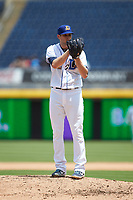 Durham Bulls relief pitcher Casey Sadler (12) looks to his catcher for the sign against the Columbus Clippers at Durham Bulls Athletic Park on June 1, 2019 in Durham, North Carolina. The Bulls defeated the Clippers 11-5 in game one of a doubleheader. (Brian Westerholt/Four Seam Images)