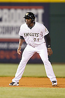 Jared Mitchell (21) of the Charlotte Knights takes his lead off of second base against the Gwinnett Braves at BB&T Ballpark on April 16, 2014 in Charlotte, North Carolina.  The Braves defeated the Knights 7-2.  (Brian Westerholt/Four Seam Images)