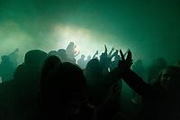 26th December 2019; Tynecastle Park, Edinburgh, Scotland; Scottish Premiership Football, Heart of Midlothian versus Hibernian FC; Hibs fans march to the stadium under a fog of green flares