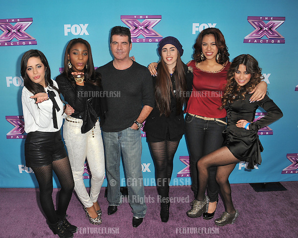 "Simon Cowell & Fifth Harmony at the press conference for the season finale of Fox's ""The X Factor"" at CBS Televison City, Los Angeles..December 17, 2012  Los Angeles, CA.Picture: Paul Smith / Featureflash"