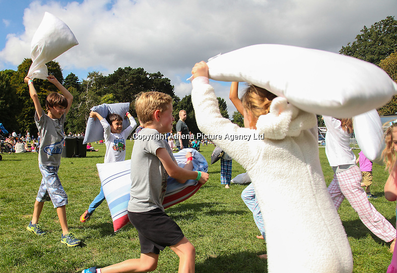 2016 09 18<br /> Pictured: Picnic goers have a pillow fight. The Great Pyjama Picnic, Bute Park, Cardiff.Sunday 18 September 2016<br /> Re: Roald Dahl&rsquo;s City of the Unexpected has transformed Cardiff City Centre into a landmark celebration of Wales&rsquo; foremost storyteller, Roald Dahl, in the year which celebrates his centenary.