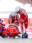 18 December 2010: Gregor Baumann starts up his 2-man bobsled for Switzerland, finishing in 12th place at the Viessmann FIBT World Cup Bobsled Championships on Mount Van Hoevenberg in Lake Placid, New York, USA. Mandatory Credit: Ed Wolfstein Photo